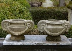 A pair of sculpted sandstone planters