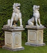 A pair of sculpted marble models of Molossian guard dogs