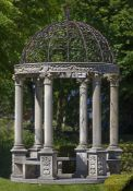 A carved limestone and wrought iron mounted garden rotunda
