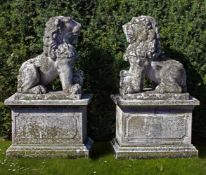 A pair of sculpted limestone models of lions on pedestals