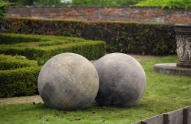 A pair of large limestone ornamental spheres