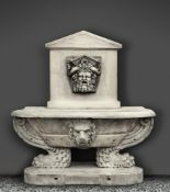 A sculpted white marble wall fountain and basin in the Renaissance style