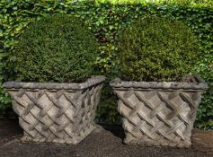 A pair of stone composition planters modelled as baskets