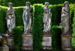 A set of four Continental sculpted limestone models of the Four Seasons