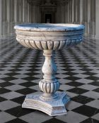 A sculpted white marble planter in the manner of a font or basin