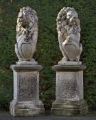 A pair of sculpted limestone models of heraldic lions