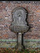 A Continental sculpted limestone wall fountain