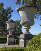 A pair of carved limestone urns, after Andrea Palladio (1508-80)