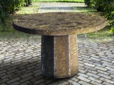 A carved stone garden table