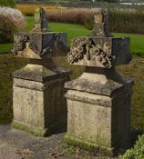 A pair of carved sandstone pier finials
