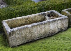 A carved limestone trough