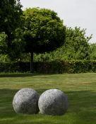 A pair of large limestone ornamental spheres