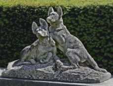 Thomas François Cartier (French, 1879-1943), a sculpted limestone group of two dogs