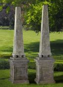 A pair of Continental limestone obelisks