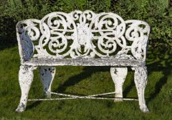 An English or French white painted cast iron garden bench