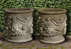 A pair of carved limestone planters