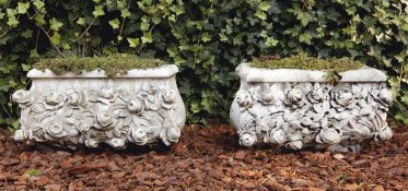 A pair of carved Carrara marble planters