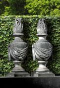 A pair of Continental carved white marble pier finials modelled as flambeau urns
