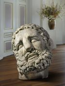 A colossal sculpted white marble model of the head of Hercules