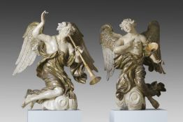 A pair of extremely fine Northern European carved and polychrome decorated wood figures of angels
