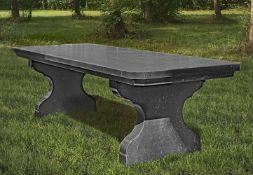 A blue stone refectory garden table