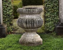 A Continental carved stone garden urn
