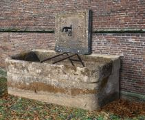 A wall fountain and trough