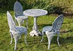 A white painted aluminium suite of garden furniture in Victorian taste