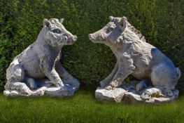 A pair of sculpted limestone models of wild boars