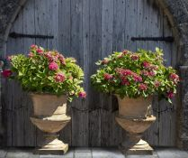 A pair of composition stone garden urns