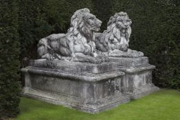 A pair of substantial and impressive stone composition garden models of recumbent lions
