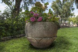 A carved limestone planter