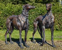 A near pair of bronze models of standing greyhounds