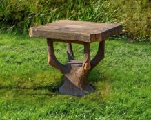A stone composition faux bois garden table