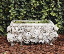 A carved Carrara marble planter