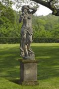 A sculpted stone garden figure of a maiden emblematic of Spring