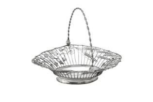 A late George II silver shaped oval swing handled bread basket by William Plummer