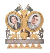 A silver gilt coloured and steel backed photo frame from Tehran City Council to Iskander Mizra