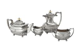 Y A silver four piece oblong baluster tea set by Walker & Hall