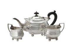Y A silver three piece oblong baluster tea set by Alexander Clark & Co. Ltd.