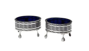 A pair of George III silver oval salts