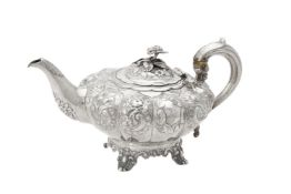 Y A Victorian silver lobed circular tea pot by William Hunter