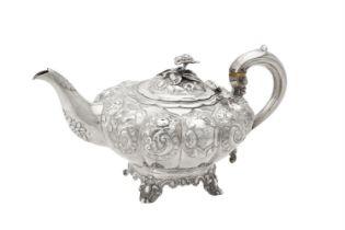 Y A Victorian silver lobed circular tea pot by William Hunter