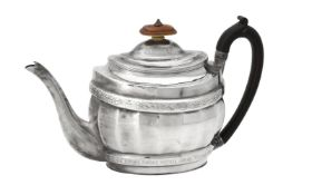 Y A George III silver oval fluted baluster tea pot by Stephen Adams II