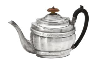 Y A George III silver oval fluted baluster tea pot by Stephen Adams II