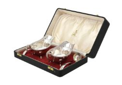 A cased pair of silver oval sauce boats and Old English pattern sauce ladles by Viner's Ltd.