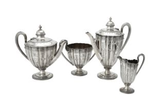 Y A Victorian silver shaped circular four piece tea set by Martin, Hall & Co.