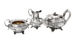 Y A Victorian silver three piece circular tea set by Benjamin Smith III