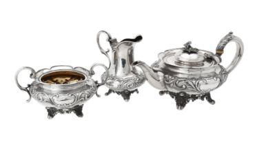 Y A Victorian silver three piece circular tea set by Benjamin Smith III
