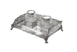 An Edwardian silver rectangular inkstand by Edward Barnard & Sons Ltd.